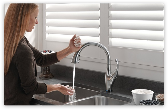 Woman using faucet